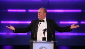 Ian Livingstone presents the award