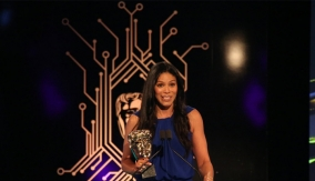 Merle Dandridge at the podium