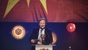 Justin Fletcher presents the award