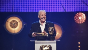 Keith Chegwin presents the award