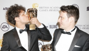 BAFTA Breakthrough Brit Daniel Gray kisses the award