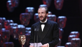 Fiennes accepts the award on behalf of Wes Anderson