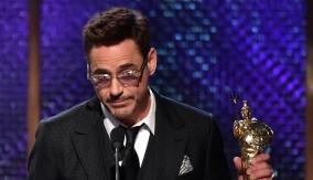 Collecting his award
