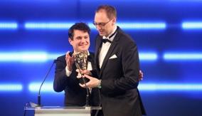 Mathew Horne presents the award