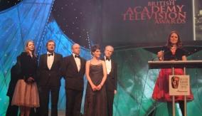 Nira Park accepts the award