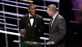 Reggie Yates and Professor Green present the award