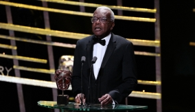 Sir Trevor McDonald presents the award