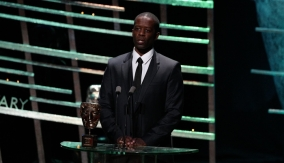 Adrian Lester presents the award