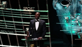 Lenny Henry at the podium