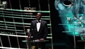 Lenny Henry at the podium