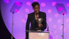 Letitia Wright presents the award