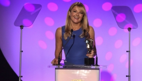 Sarah Hadland presents the award