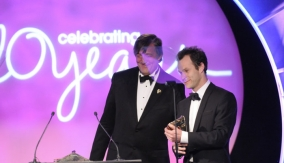 Stephen Fry presents the award