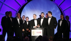 The winners accept the award