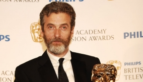 Capaldi poses with the mask