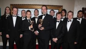 The team pose for cameras