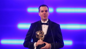 Josh accepting the award