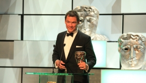 Dominic West accepts the leading actor BAFTA