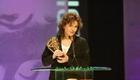 Valdis accepts the award