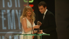Owen collects the award