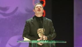 Santaolalla accepts the award