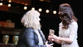 Olga Kurylenko presents the award