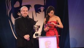 David Arnold and Riva Taylor present the award