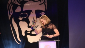 Ashley Johnson accepts the award