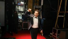 Ethan Hawke celebrating backstage