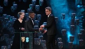 John Boyega and Alice Eve present the award