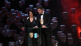 Anna Pinnock and Adam Stockhausen at the podium