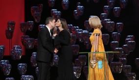 Léa Seydoux and Monica Bellucci present the award
