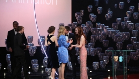 George MacKay and Olivia Grant present the award