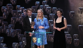 The winning team at the podium